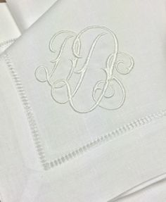 Custom 'Gwyn' monogram on hemstitched linen napkins. Placemats, cocktail napkins, table runners and guest towels also available. http://www.bellalino.com/Luxury%20Table%20Linens/gwyn_signature_table.htm