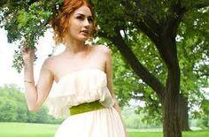 Wedding dress with green sash. https://www.marygoldweddings.com