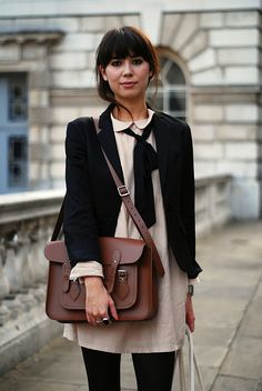 black blazer, cream collared dress, black bow & black leggings w/ brown bag