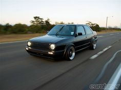 Here is the 1991 VW Jetta Coupe that underwent chassis upgrades, adding a modern twist is a carbon fiber hood, Driver's Edition brakes, drilled rotors, and more. Volkswagen Jetta, Vw Passat, Slammed Cars, Bugatti, Lamborghini, Vw Mk1, Ford Ecosport, Volkswagen Polo, Vw Cars