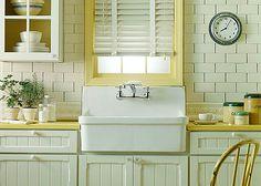 LOVE LOVE LOVE! Farmhouse sink, beadboard cabinets AND subway tile. Dream Kitchen