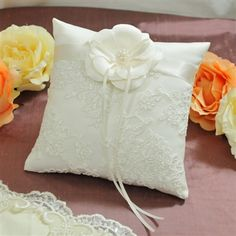 Ring pillow with lace from Calvert's dress, no Flower, but still looking for ideas