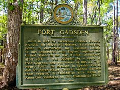 "Fort Gasden ""Negro Fort"": Built in 1814 by Lt Col Edward Nichols, his Majesty's Marines, as a rallying point to encourage the Seminole Indians to ally themselves in the War of 1812. Abandoned after 1814, it was occupied by a band of free Negroes and was known by 1816 as ""The Negro Fort."" It's location did not deter Maj Gen Andrew Jackson from ordering its elimination as a threat to American commerce on the Apalachicola River. (cont other side)"