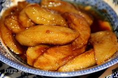 A classic southern side, slices of apples are fried in a mixture of bacon fat or butter and brown sugar then tossed in a dusting of traditional apple pie spices.
