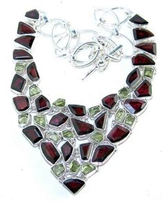 Beautiful item with Peridot Rough, Garnet Faceted Gemstone(s) set in pure 925 sterling silver.