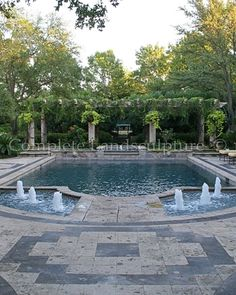 Formal pool with low fountains