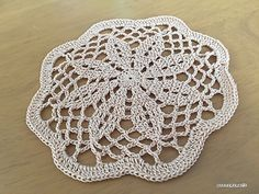 It's about 14cm in diameter, so it can be used as coaster.--flower mini doily