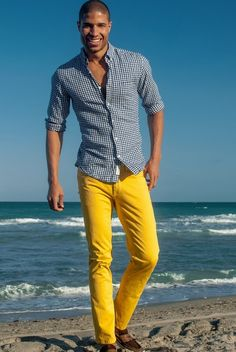 Shop this look on Lookastic:  http://lookastic.com/men/looks/navy-and-white-gingham-long-sleeve-shirt-yellow-jeans-dark-brown-suede-loafers/11352  — Yellow Jeans  — Dark Brown Suede Loafers  — Navy and White Gingham Long Sleeve Shirt