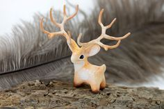2.7 inch in length (with antlers), velvet clay, acrylic. I can send it in a way as it is now (Without changes), or can draw on the trees as the Moon Wanderers (With tree ... #brown #statuette
