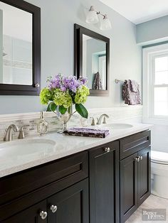 Beige isn't the only option when you want peace and quiet. This bathroom mixes muddied-up shades of gray and blue with soft cream trim to achieve its soothing attitude. An accent band around the room's perimeter continues the color scheme and visually expands the space, while a few touches of black give it an of-the-moment update. Paint Color: Earl Grey, Sherwin-Williams/