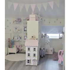 Barnerom / Kids room with Miffy lamp, bunting flags, and Le Toy Van Town House dollhouse. idakristinlokken on Instagram.