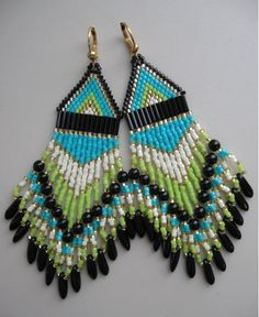 Slightly heavy, but not too heavy.  These pretty bead woven earrings are handmade with 6mm black bugle beads, black, turquoise, lime/chartreuse, cream,