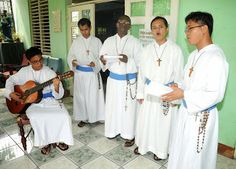 Father Richard Ho Lung's Missionaries of the Poor; (l-r) Brothers James, Roche, Edward, Cipriano and Richie at song and prayer.  MOP was founded in Jamaica in 1981 to serve the poor and abandoned.