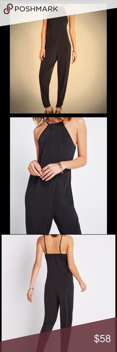 """Cross-Front Halter Jumpsuit As comfortable as it is chic, this jersey jumpsuit will quickly find itself on high rotation in your wardrobe.  Square neckline. Sleeveless with adjustable straps. Cross-front design. Tapered leg. Full-length inseam, 27.5"""". Self: Polyester, Spandex jersey. Machine Wash. Imported. BCBG Pants Jumpsuits & Rompers"""