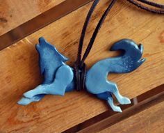 Howling Wolf Necklace can be made in any color by WILDatHEARTart, $24.99
