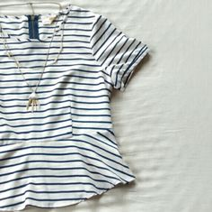 ⚓Striped Peplum⚓ Adorable off white/navy striped peplum top. Made in Canada. 100% polyester. Zipper up the back, split at bottom hem. Buttons at sleeve.  Add a nautical touch to any casual or dressier outfit! Pins & Needles Tops