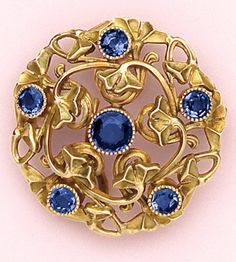 Montana sapphire and carved gold brooch. At the turn of the century, a great sapphire mine was discovered in Montana. Tiffany among other jewelers rush to procure a supply of these very bright blue sapphires. Unfortunately most of the finest sapphires from this mine were all but exhausted by the 1920's.