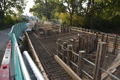 Compasses Bridge construction, Wey and Arun Canal, Alfold, Surrey. A view of the reinforced and partially shuttered decking, looking south towards the Compasses pub, just visible in the background. (Oct 11, 2015.)