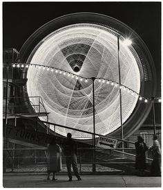 Long exposure shots of fairground rides in Coney Island by Andreas Feininger, The Gyro Globe Coney Island, New York, 1949