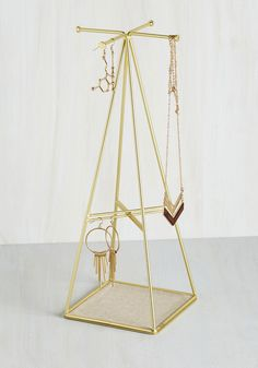 Flair for the Prismatic Jewelry Stand. Display your prized possessions in captivating style with this geometric jewelry stand. #gold #modcloth