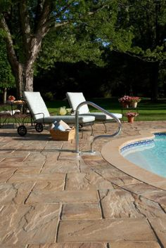 pool deck with unilock beacon hill flagstone and series3000 paver