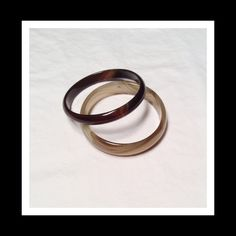 """Glass bangles This is a set of two glass bangles with marble detailing. They are simply stunning and in perfect condition. They each measure approx 10"""" around; the dark brown marble is just under .5"""" in width and the taupe marble is just under .75"""" in width. Jewelry Bracelets"""