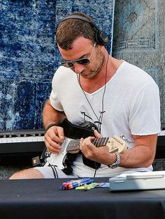 Is he a budding rock star? Liev Schreiber finds the perfect tune while jamming with his family (not pictured) at the Brentwood Farmers Market in L.A. http://www.people.com/people/gallery/0,,20789825,00.html#30108329