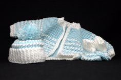 blue crocheted baby layette