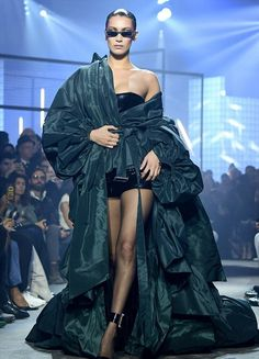 d89eef2a7da6a Bella Hadid Suffers A Nip-Slip As She Sashays Down Catwalk In Ruffled Gown  For