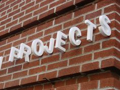 Original cartel. Projects Signage: 3D Typographic Sign