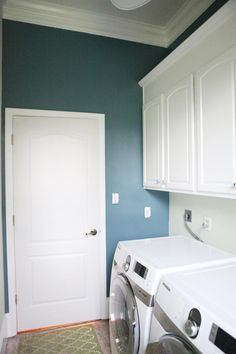 laundry room--love the bright blue she painted her white laundry room. (the color name is Kerry Blue by Martha Stewart if you want to know).