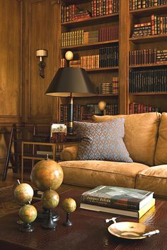 I have always loved a wood paneled library/ office. I can see myself quietly reading a book in the warm, inviting study. What happened to these traditions?