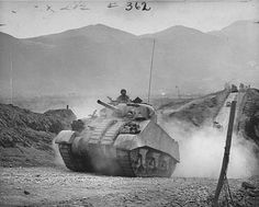 American M4 Sherman tanks rumble along road during the Allied push to take the town of Cassino. Pin by Paolo Marzioli