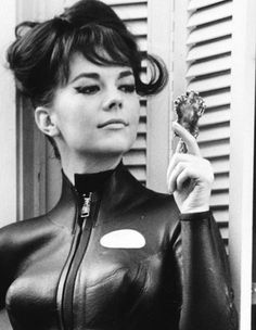 Here we see Mela and/or Natalie Wood in her/their evening job as Emma Peel.