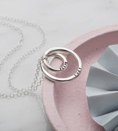 Our beautiful new Personalised Mummy and Baby Forever Necklace symbolises the eternal bond between mother and child. A unique looped pendant, handcrafted from sterling silver, represents the continuous nature of everlasting love. For a truly special touch the pendant can be personalised with your own unique message, popular personalisations include names, dates, meaningful quotes, song lyrics and expressions of love. Alternately if you would like your necklace without personalisation please…