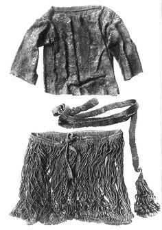 Costume of the Egtved Girl, 1370 BC. Early Bronze Age clothing; the photo shows a short-sleeved tunic or shirt, a belt ending in a loop carrying a metal disk (fibulae/fibula/fibule), and a string skirt ending in a fringe and sewn to a woven waist-band.