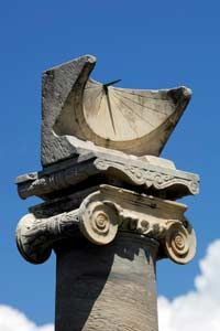 Ancient Roman Sundial: 1 of the 2 remaining ionic columns in front of the Temple of Apollo. Erected in 5th century BCE. Pompeii, Italy.