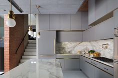 The burnished copper handles and marble worktop/splashback make this bespoke kitchen distinctive Style de Décoration Intérieure Govotsis: A matt lacquer kitchen with brass cladding from Roundhouse Design Luxury Kitchen Design, Kitchen Room Design, Home Room Design, Kitchen Cabinet Design, Home Decor Kitchen, Interior Design Kitchen, Kitchen Furniture, Home Kitchens, Brass Kitchen
