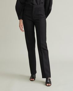 Modern yet classic suit trousers featuring a tailored silhouette with pockets and a hidden zip at the front. Mid-rise Straight slim leg Front pockets Single back welt pocket Flat front Polyester / Wool Model is ft 9 in and is wearing a size S Trouser Suits, Trousers, Pants, Classic Suit, Slim Legs, Welt Pocket, Apothecary, Designing Women, Silhouette