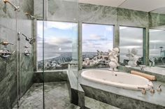 This beautiful estate offers stunning panoramic views of the surrounding area, which includes the Pacific Ocean. So whether you are taking a bath or hopping in the shower, you can still enjoy the scenery from the bathroom!