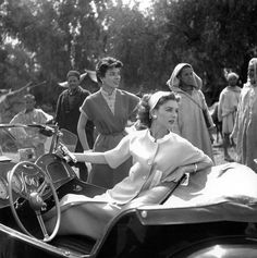 Suzy Parker in suit by Basta and Françoise Dambier in dress by Weil, photo by Georges Dambier, Morocco, ELLE, April 27, 1953