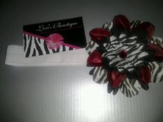 Beautiful Deep Red & Zebra Print Flower Headband w/ Double sided ultra soft elastic band. $8.00, via Etsy.