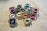 Simply ingenious idea for making bobbin covers - no more spiderwebs of thread.