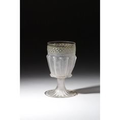 Standing cup from Venice, Italy, circa 1475-1525. Colourless glass, the foot and lower part of the bowl in a dip-mould, enameled and gilt