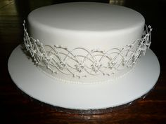 Beautiful smooth fondant and intricate detailing - Oriental String work by kirstyannb, via Flickr