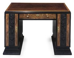 AN ART DECO WALNUT, CARVED AND BLACK PAINTED PEDESTAL DESK