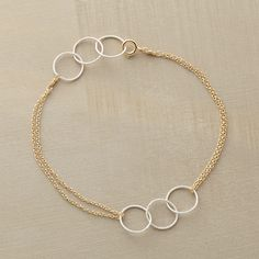 """THROUGH HOOPS BRACELET--In this golden chain and sterling hoops bracelet, sterling silver hoop trios are suspended between double 14kt goldfilled chains. Spring ring clasp. Handcrafted in USA. 7""""L."""