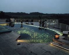 The Galaxy Pool - To get the effect of the deep dark sky in a 900-square-foot pool, designer Ron Gibbons custom-blended marble-dust aggregate and three blue hues of colored crystal aggregate into the pool basin's finish. And for the twinkle of the stars, he installed more than 2,200 fiber-optic lights.