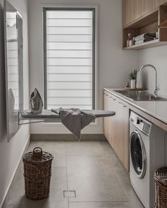 The ultimate laundry design guide! above washer and dryer small laundry rooms Laundry Room Design: The Ultimate Guide! Laundry Room Cabinets, Laundry Room Storage, Laundry Cupboard, Kitchen Cabinets, Kitchen Sink, Kitchen Backsplash, Laundry Room Floors, Basement Laundry, Wall Cabinets