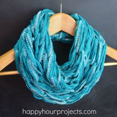 "Arm-knitting Video - Light-weight Spring Infinity Scarf at www. happyhourprojects.com - Uses less than one 35 yard skein of new ""ruffle"" yarns! (Shown in Honey Bee Chrysalis Metallic yarn.)"